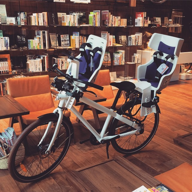 VanMoof electric bike with two child seats.